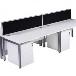 Block of 4 white desks with pedestals