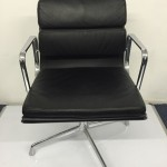 TWO Eames style leather meeting chairs